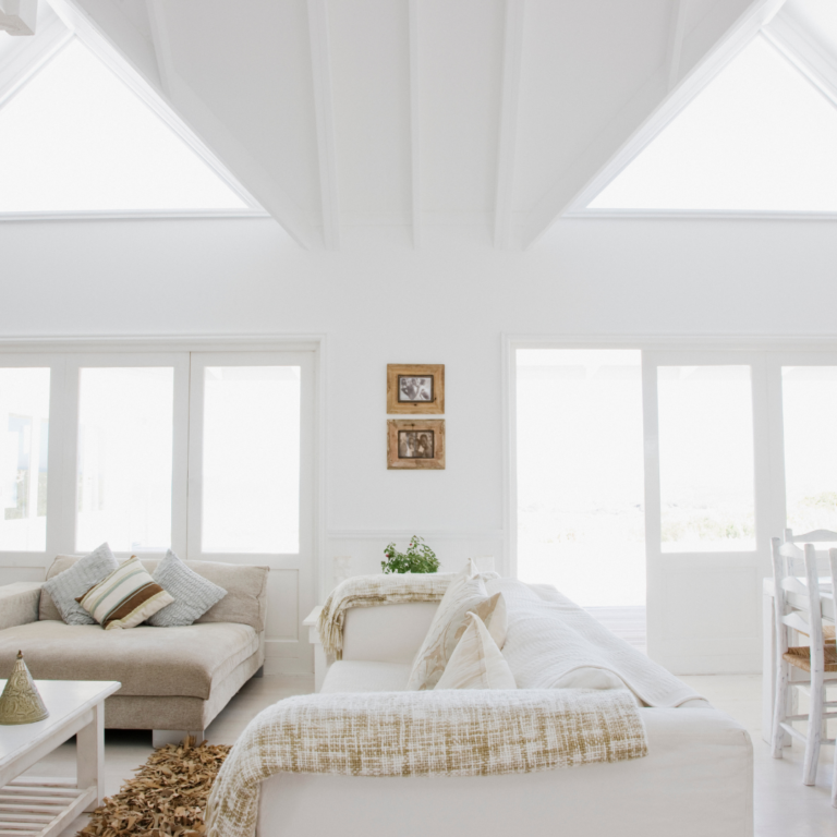 white modern home. should i rent or buy a home? real estate investing 101 basics